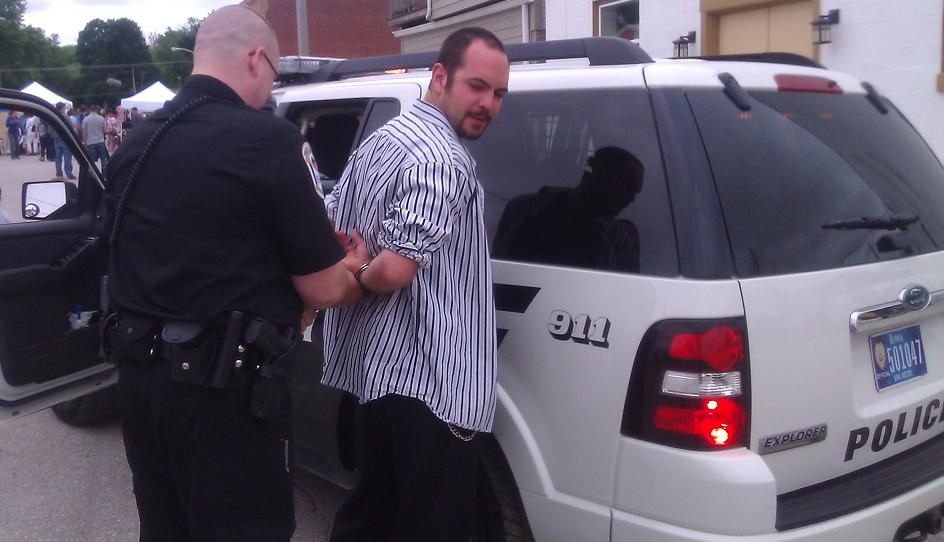 POLICE ARRESTING Nathan Allen The Maniac of Magic Iowa Comedian Iowa Magician Iowa Entertainer Iowa Entertainment